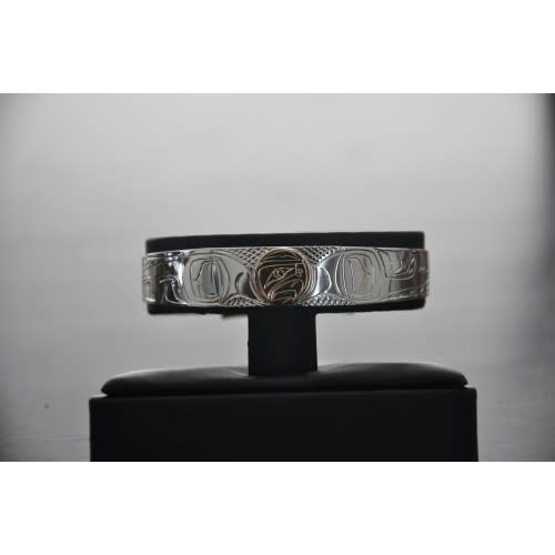 """1/2"""" Wide hand carved silver Bracelet With a 14Kt Gold Disc In The Eagle Design.  Handmade by Nancy Dawson-1"""