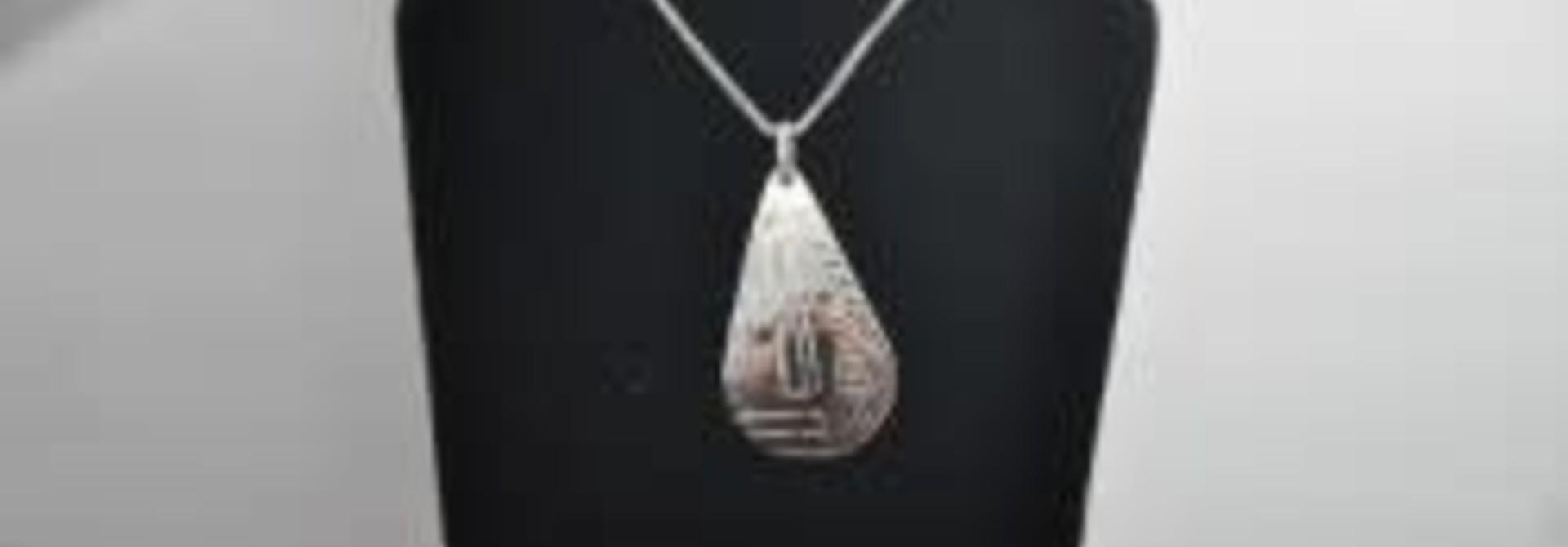 Silver Carved Raven Pendant by Vincent Henson