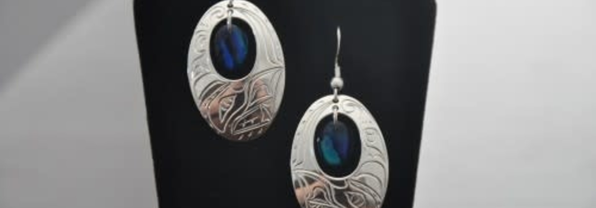 Silver Carved Oval Eagle Earrings with Blue Paua Shell by Vincent Henson