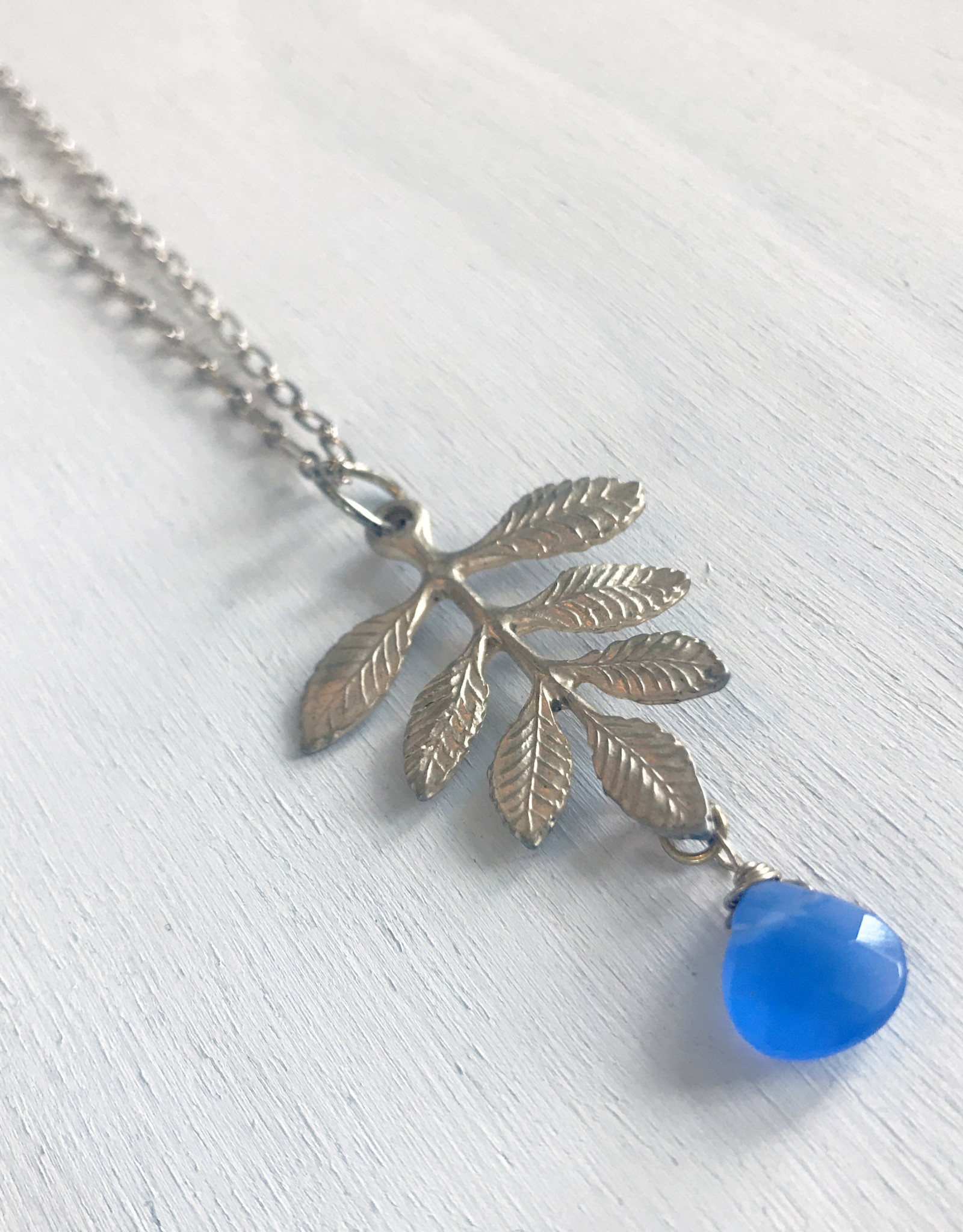 """Devil May Wear Fern Pendant. Blue Glass Drop. Gold plated pendant. Gold plated Chain. 24"""""""