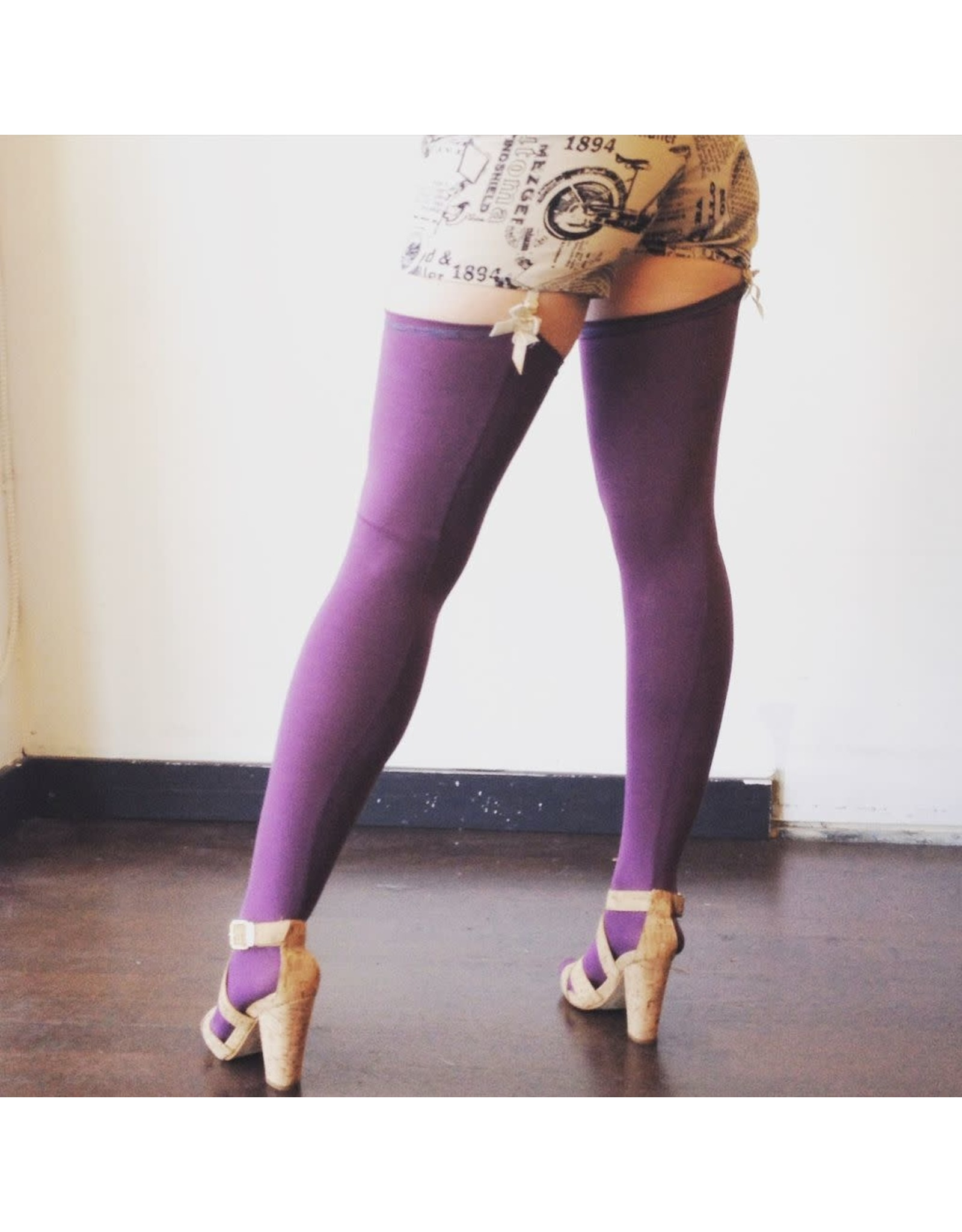 Devil May Wear Thigh High Bamboo Stockings. Seam Up the Back and in Toe. 95% Viscose from Bamboo, 5% Spandex. Must Use Garters. Flint