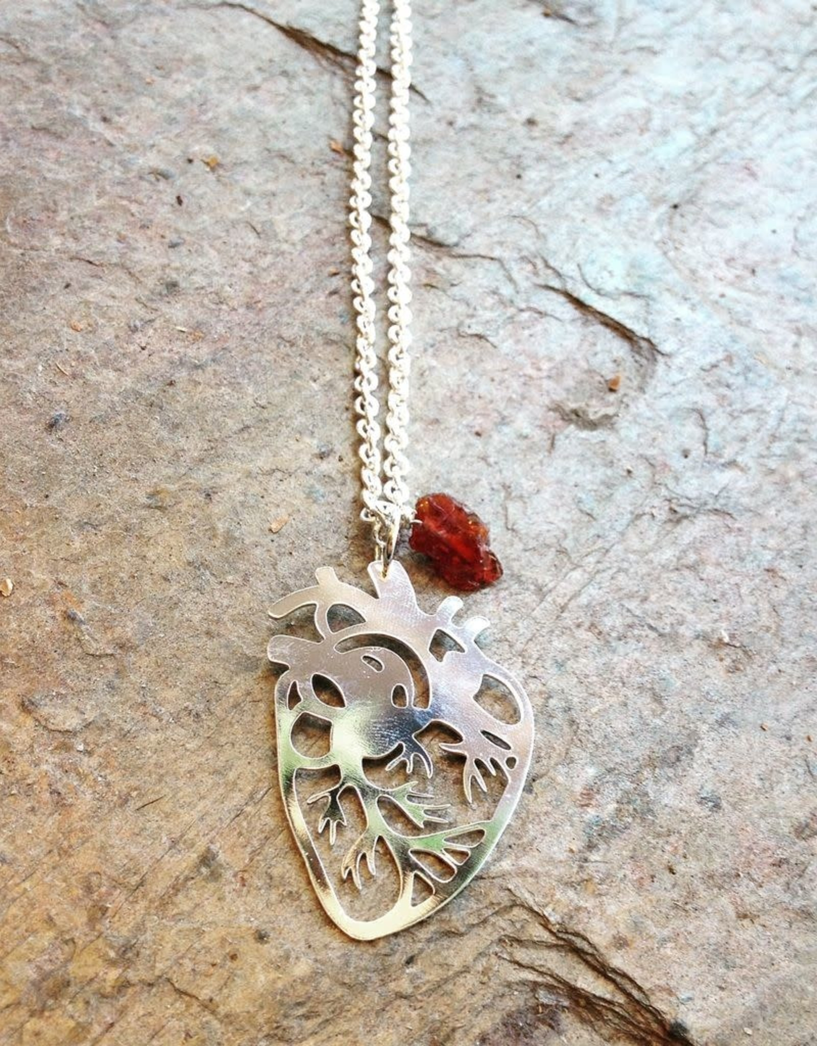 Devil May Wear Anatomical Heart Necklace. Silver Plated hear cut out with rough Garnet stone.  24""