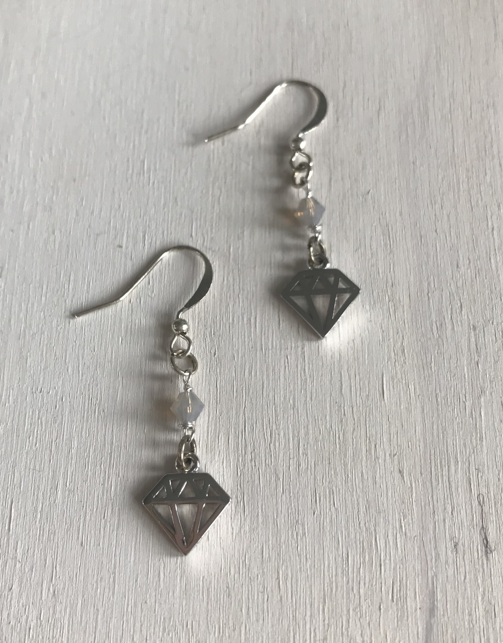 """Devil May Wear Girl's Best Friend Earrings. Tiny Damond cut out in plated silver. Swarovski Crystal. Silver fill hooks. 1"""""""
