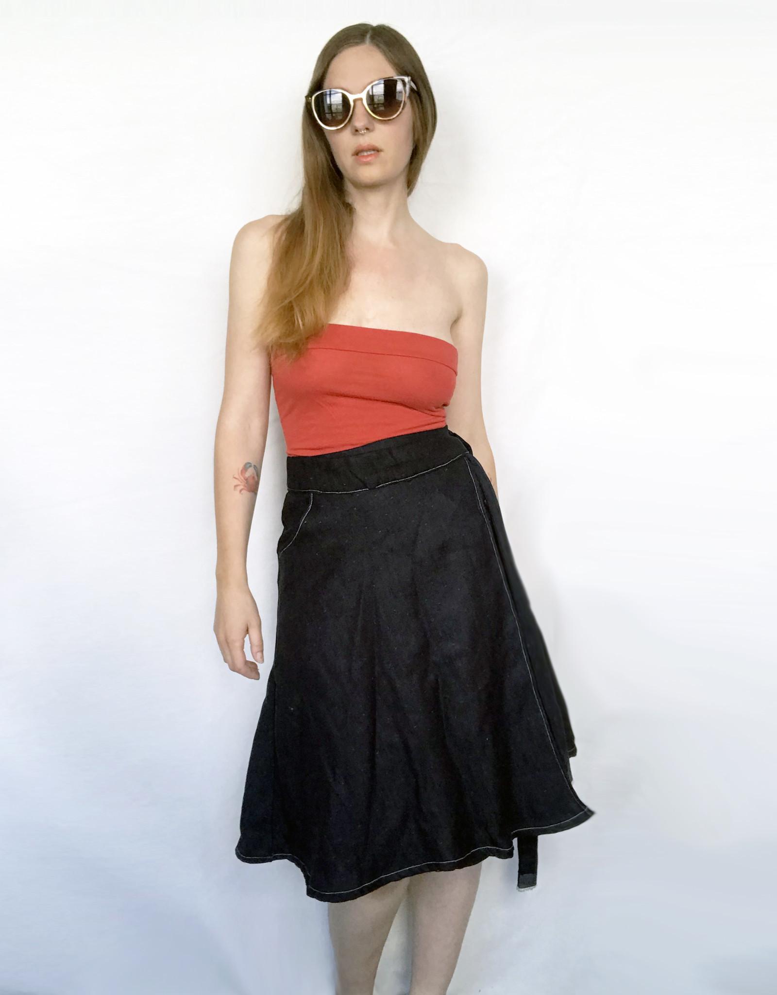 Devil May Wear Winona Denim Wrap Skirt. Tied waistband. A-Line Silhouette.