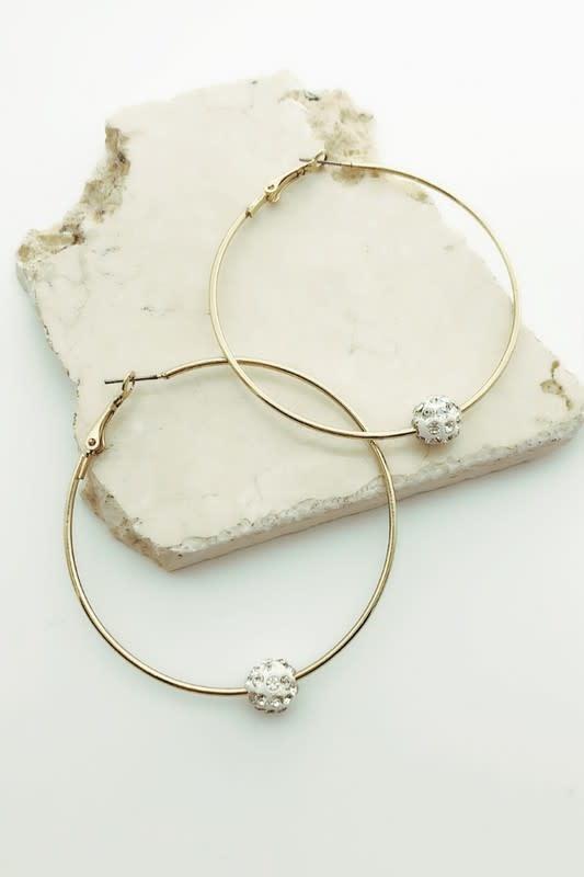 Ball in a ring earrings