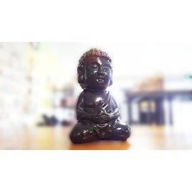 Medatating Buddha With Egg