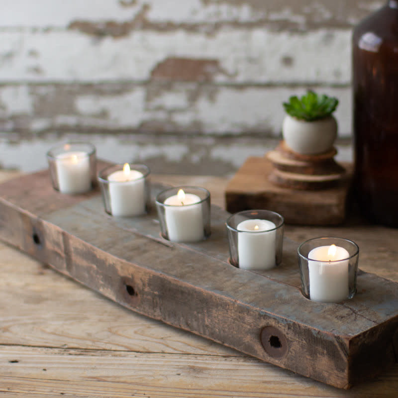 Recycled wooden beam with five glass candle holders