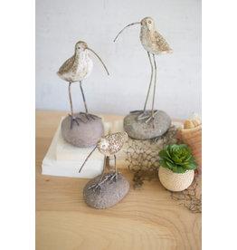 Clay shore bird on rock base