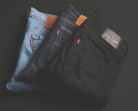 an assortment of men's jeans in different colours