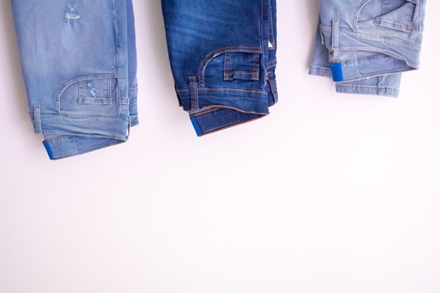 Three pairs of jeans on a white background