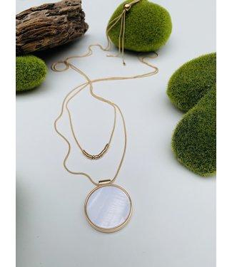 White Pendant on Gold Chain
