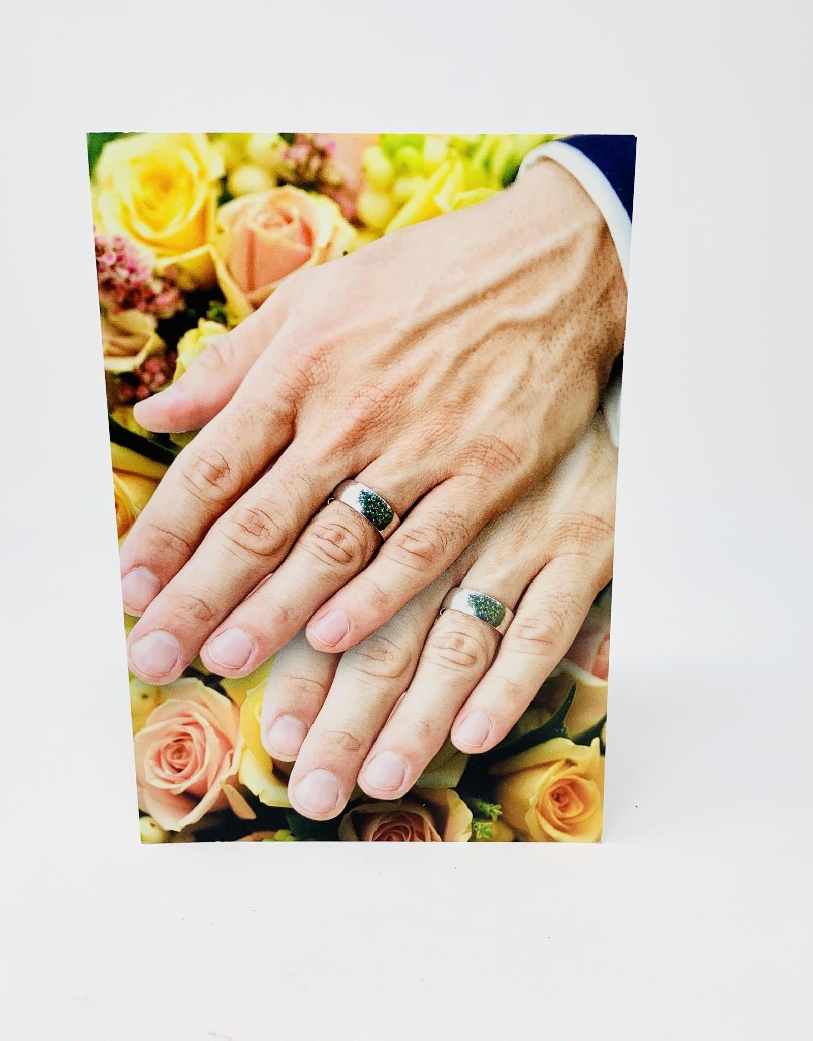NobleWorks Two men wedding rings