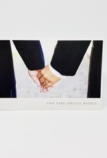 Pictura 2 grooms holding hands