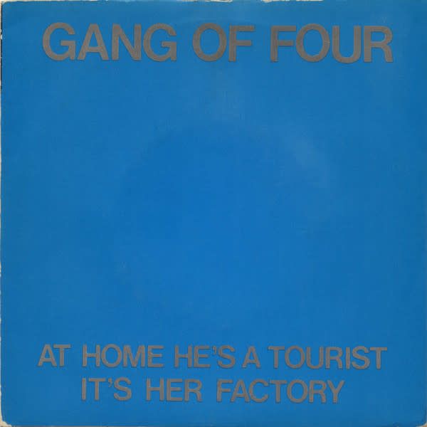 Rock/Pop Gang of Four - At Home He's A Tourist b/w It's Her Factory (VG, creases, stain, tape on sleeve)
