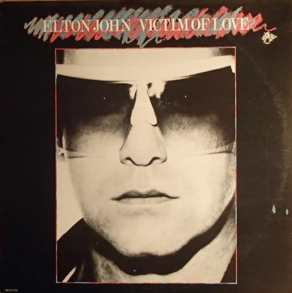Rock/Pop Elton John - Victim Of Love (VG+; hole punch, shelf-wear)