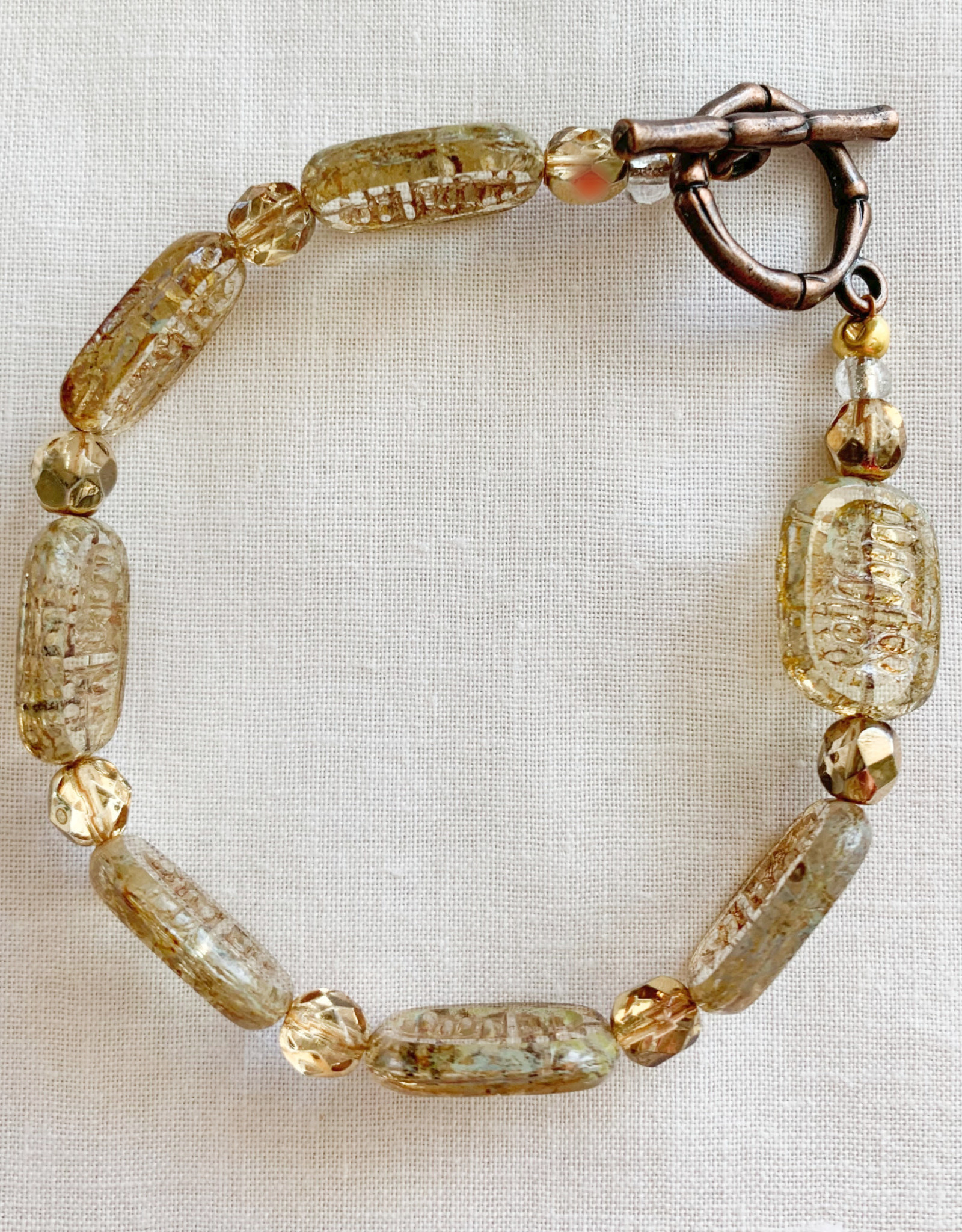 DE LA TERRE AMBER CZECH BEAD WITH BRASS TOGGLE