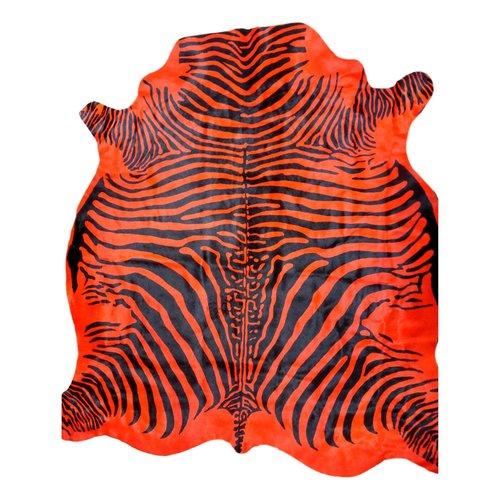 Tapis en peau de vache orange style zèbre