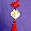 YEAR OF THE OX GOLD MEDALLION ON RED SILK CORD WITH TASSEL