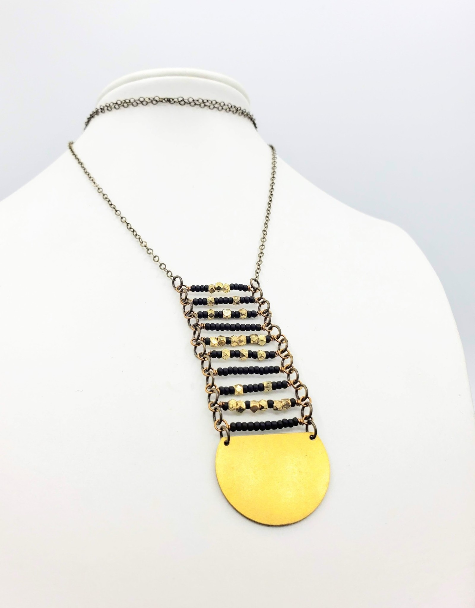 Long ladder necklace with brass half-circle drop and black and brass beads