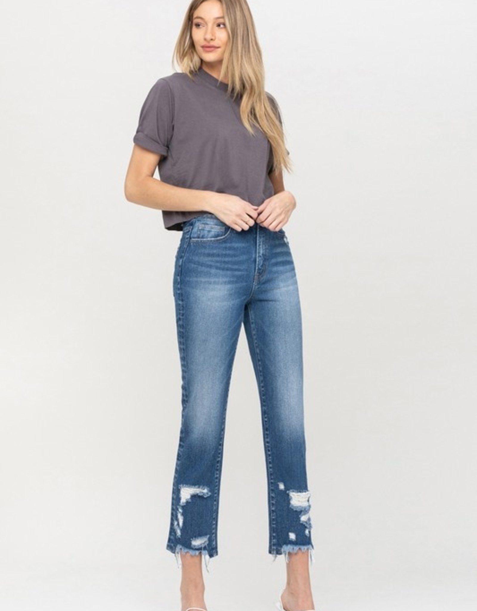High waist distressed bottom jean