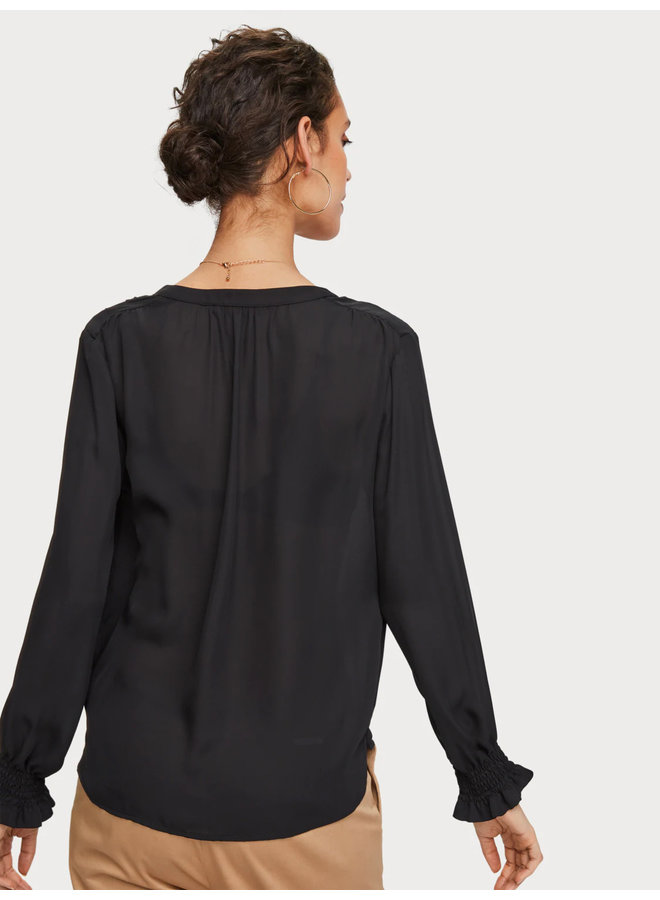 Wrap-over top with smocked cuff