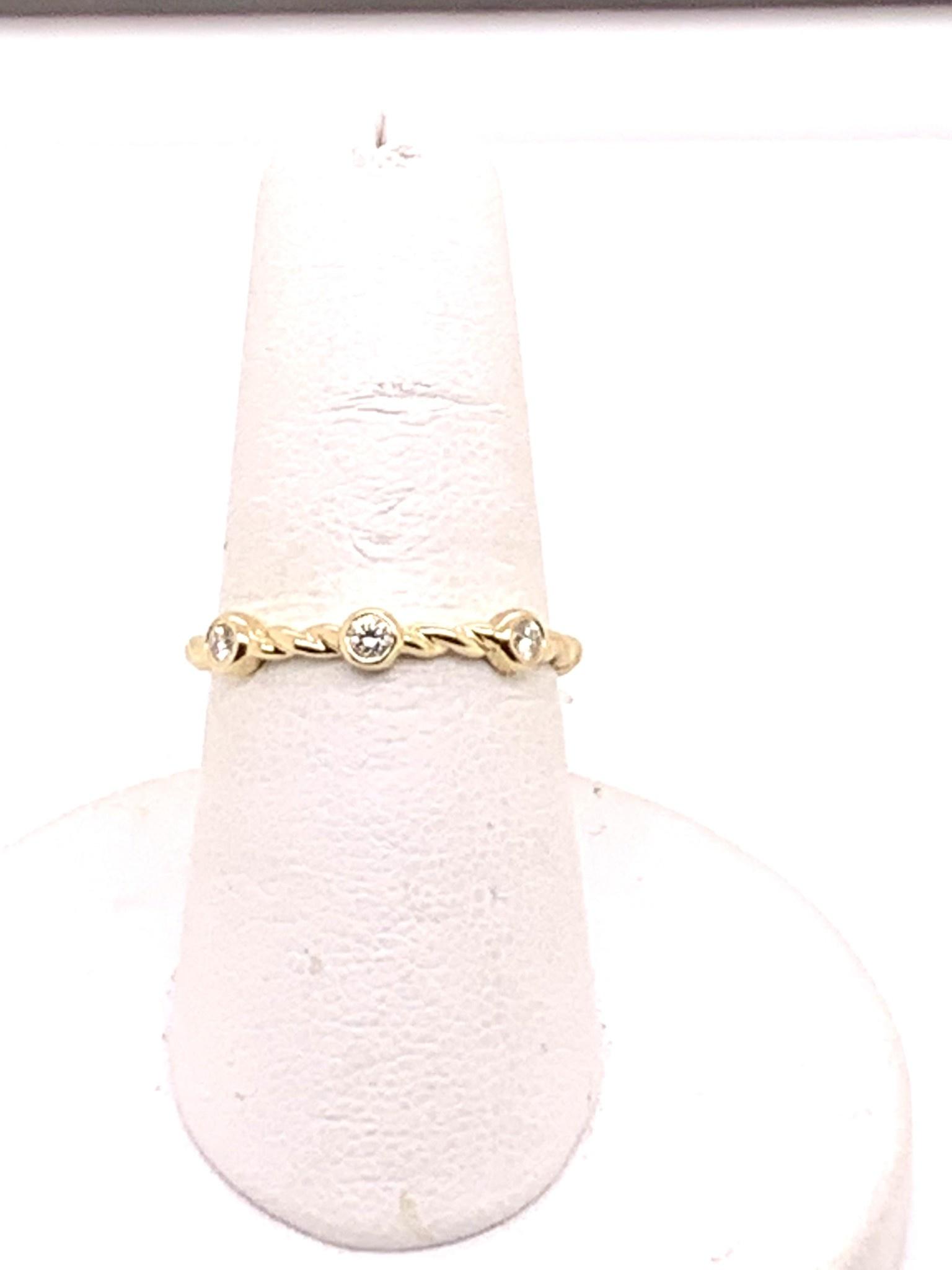 Yellow gold 0.10ct diamond three stone twisted wedding band