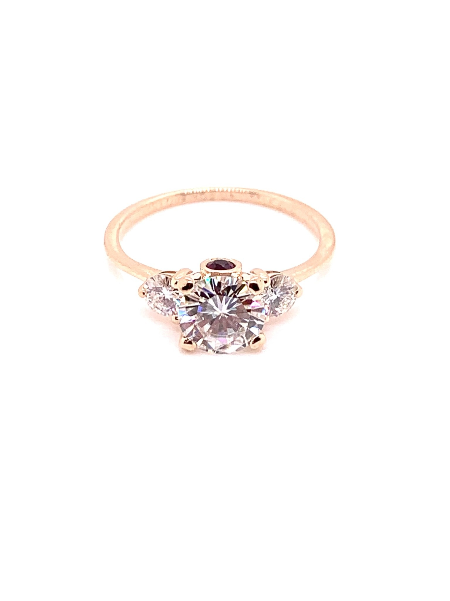 14K rose gold 3-stone moissanite ring with rubies