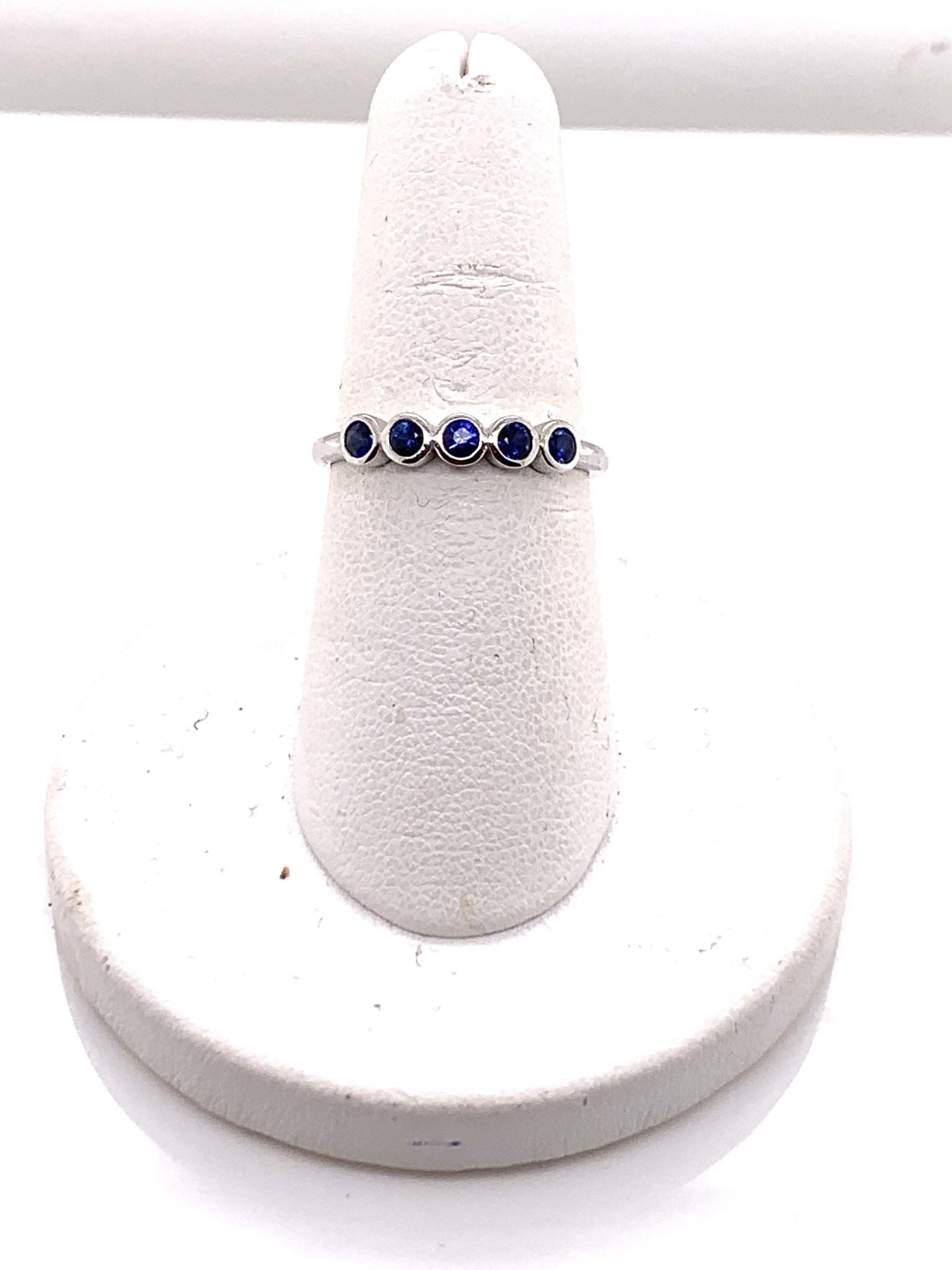 14K white gold 5-sapphire bezel set band size 6.75