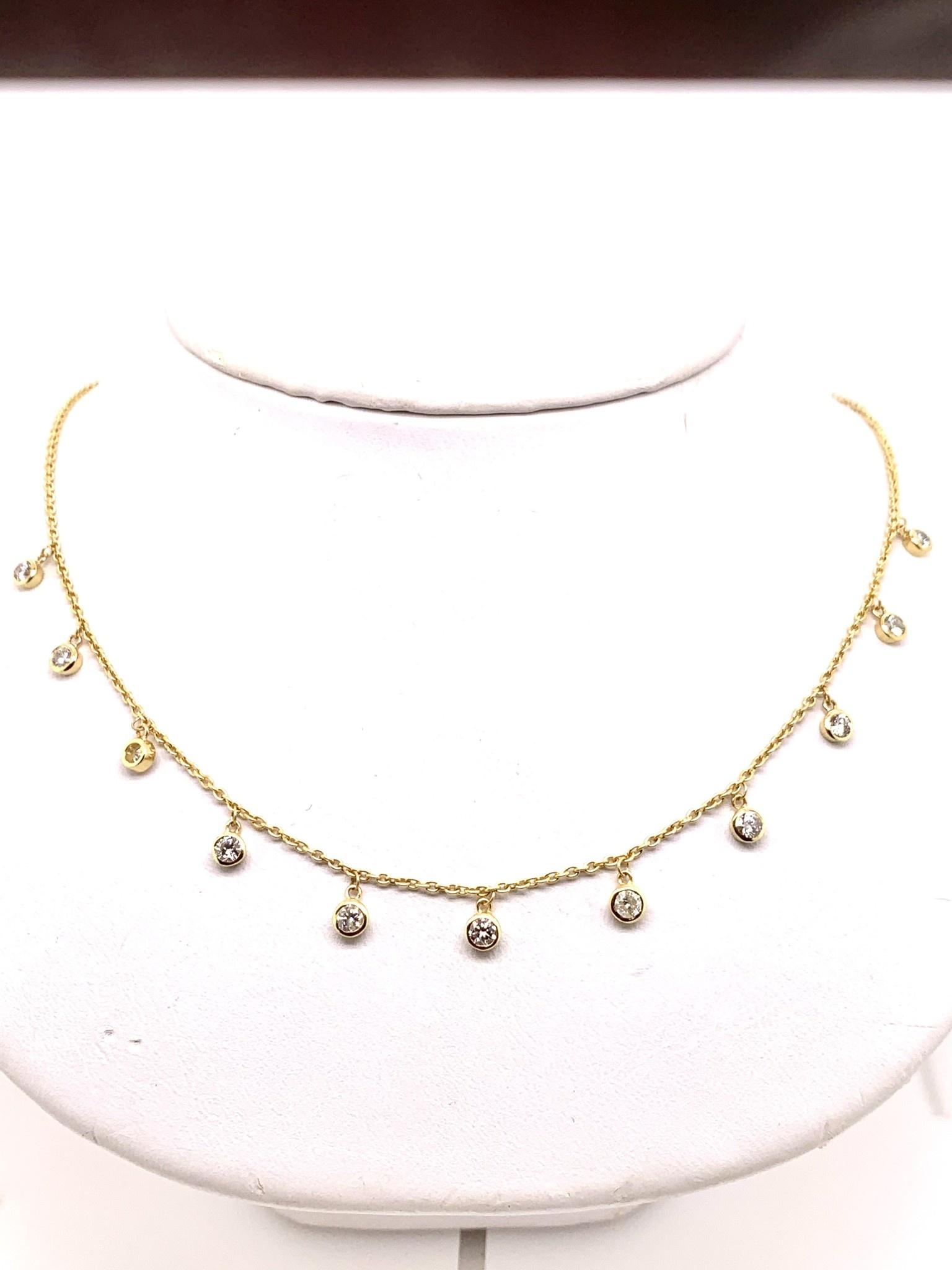 14K yellow gold 1.10ct diamond bezel set dangle necklace 17 in