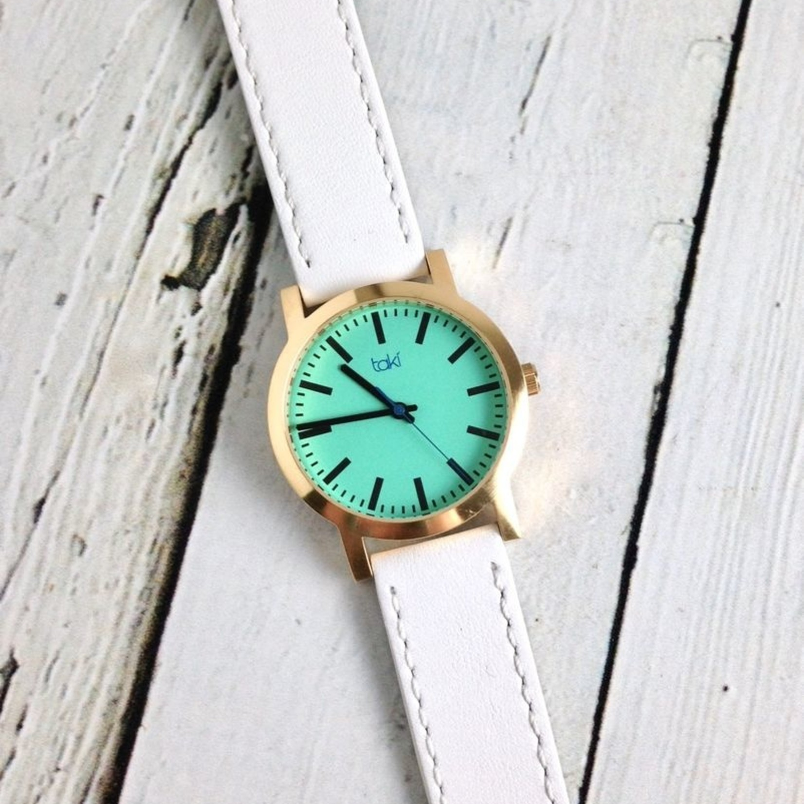 Eden Watch, Turquoise Face and White Band with a gold-tone bezel