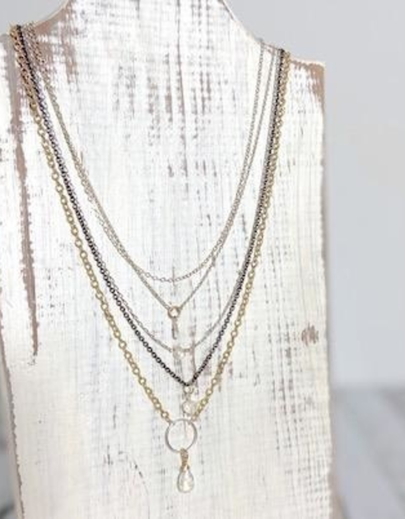 EVANKNOX Handmade Multi-strand Necklace with shiny sterling silver, oxidized sterling silver and 14k goldfill chains with rainbow moonstones.