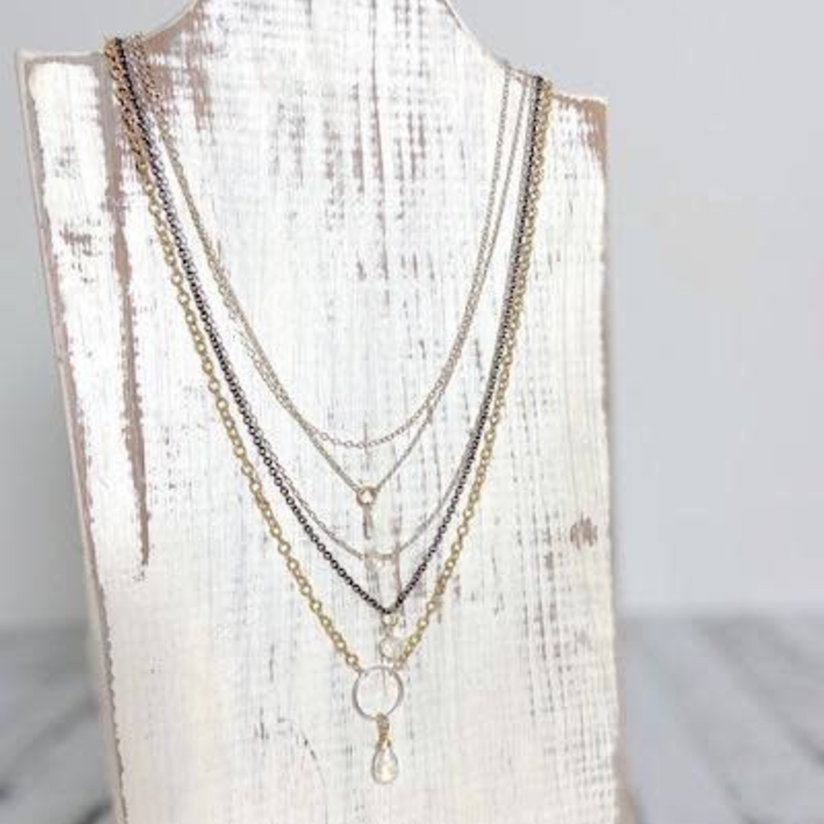 Handmade Multi-strand Necklace with shiny sterling silver, oxidized sterling silver and 14k goldfill chains with rainbow moonstones.