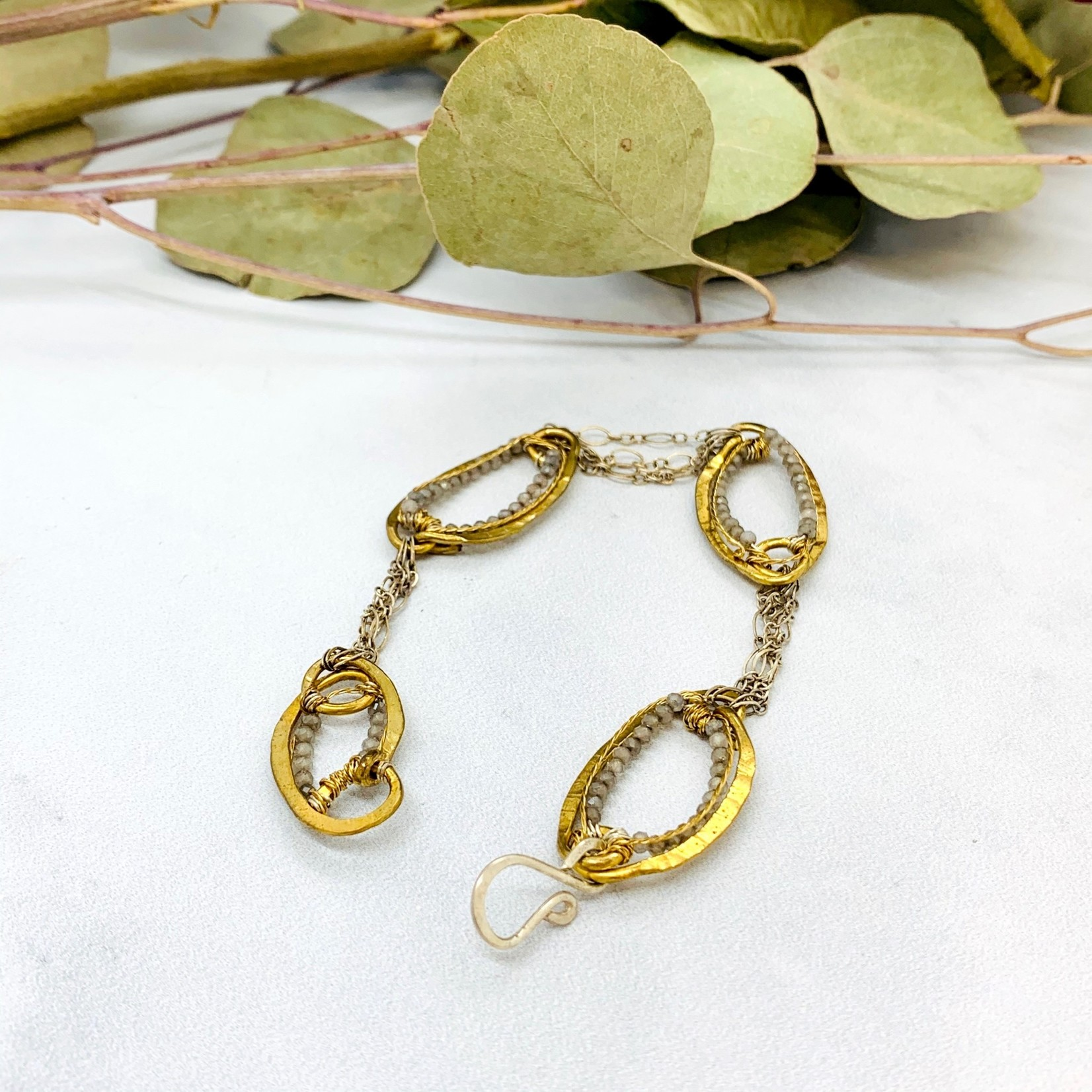 Handmade Brass Ovals beaded with Bear Quartz and connected with Sterling Silver Chains. Hook Closure