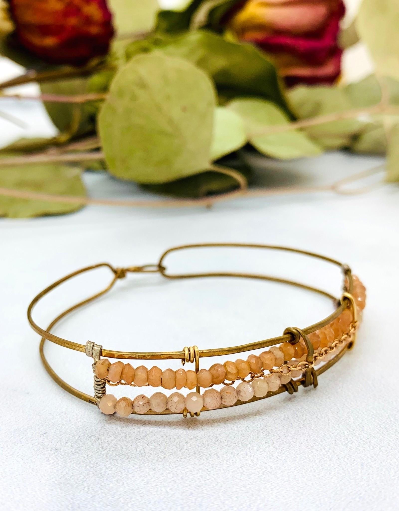 Handmade peach moonstone and rose gold filled chain beaded on hand formed bronze bracelet.