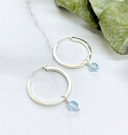 Handmade Silver Earrings with larger shiny hoop, sky blue topaz ball