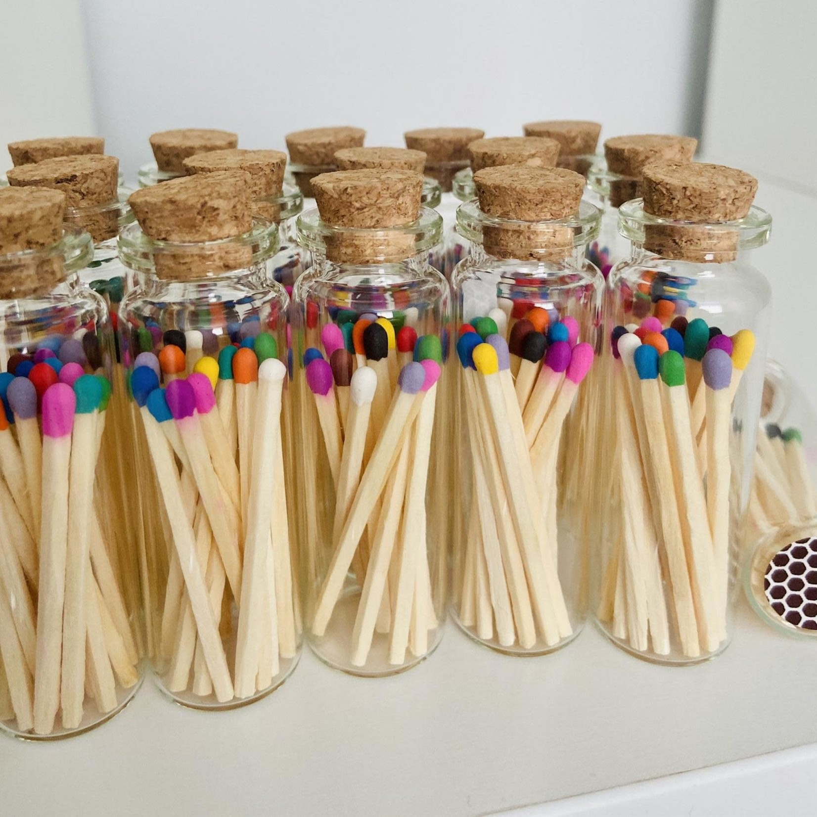 Glass bottle with 15 rainbow matches