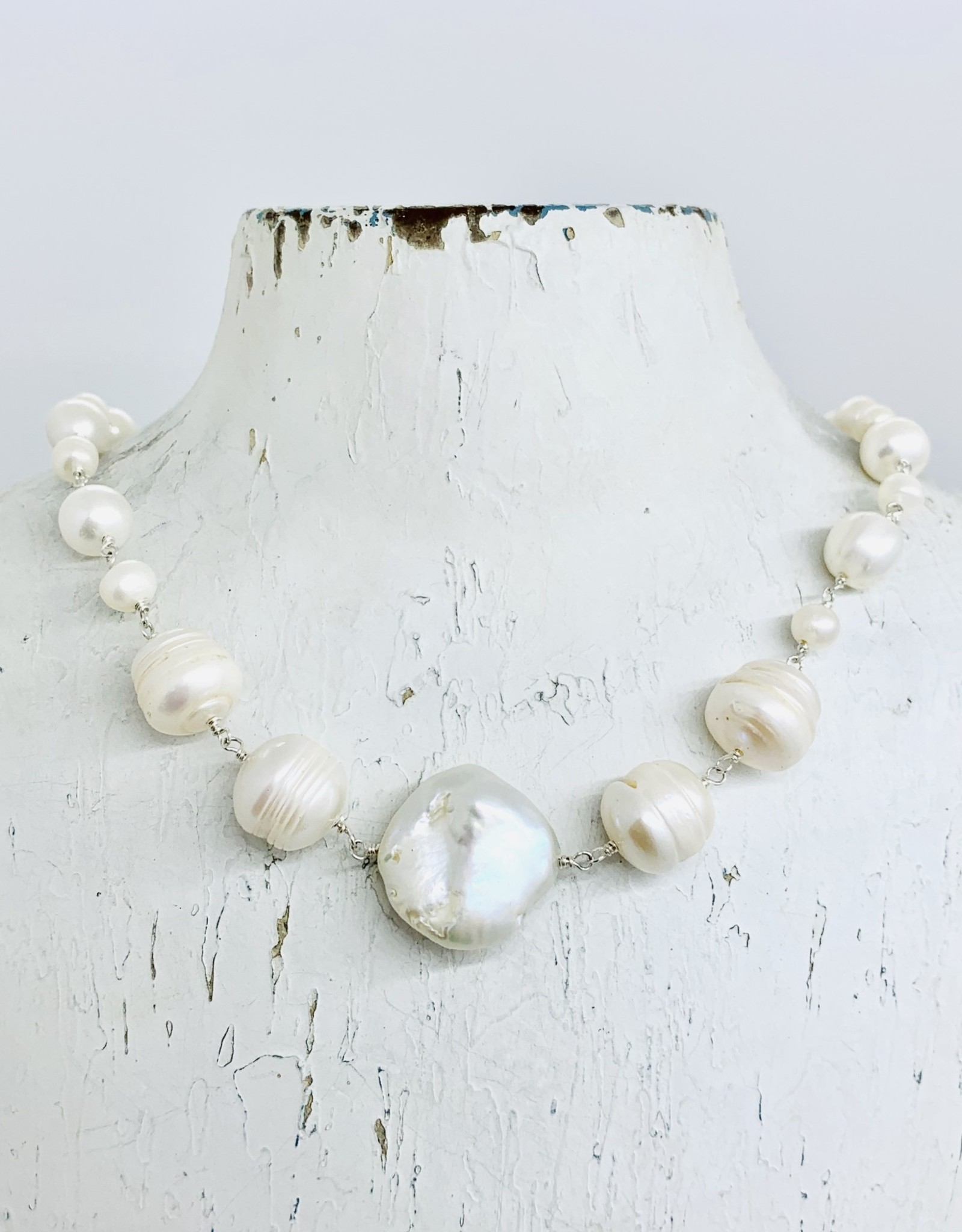 Handmade Necklace with graduated connected white pearls, 1 baroque in center