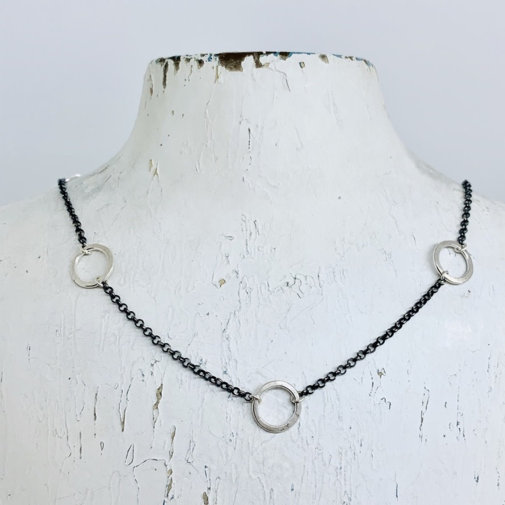 Handmade necklace with 8 shiny hammered rings, oxidized chain