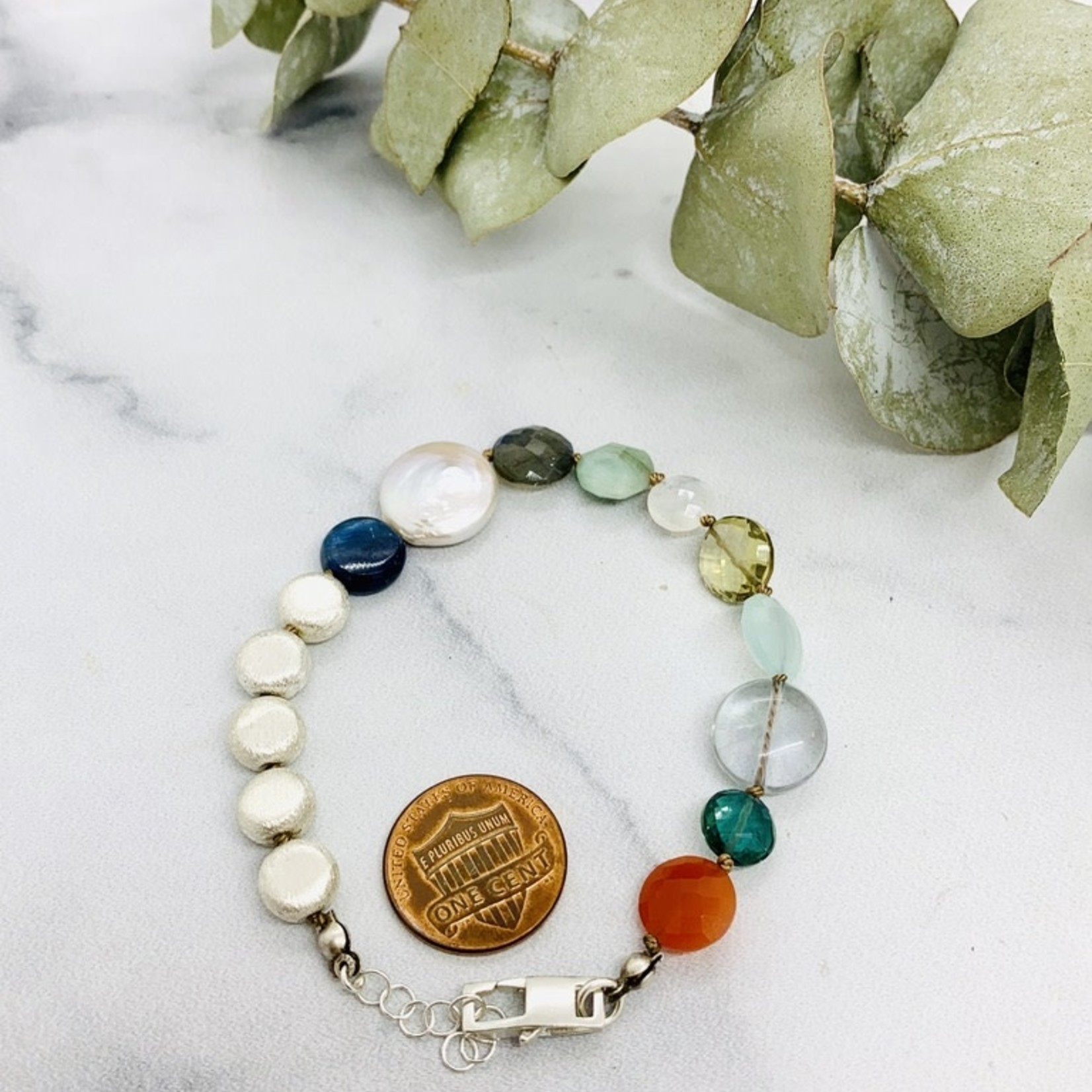 Handmade bracelet with 5 small brushed silver coins, coins: kyanite, white pearl, labradorite, emerald, rainbow moonstone, lemon quartz, peruvian chalcedony, fluorite, green hydro, carnelian knotted on natural silk