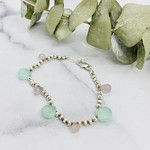 Handmade bracelet with 4 pink chalcedony briolette, 3 green chalcedony briolette, 4 silver discs between each knotted on natural cord