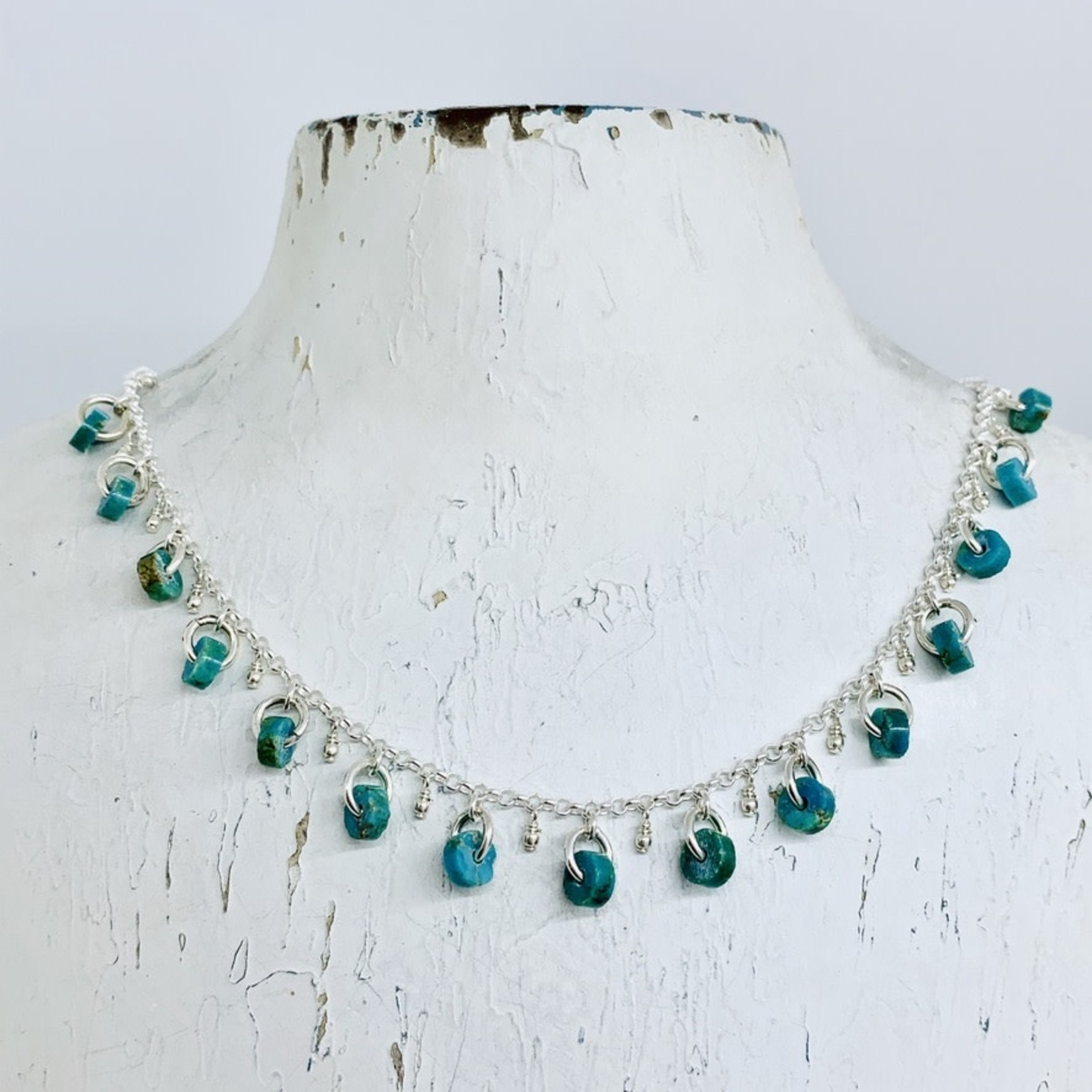 Handmade necklace with turquoise discs