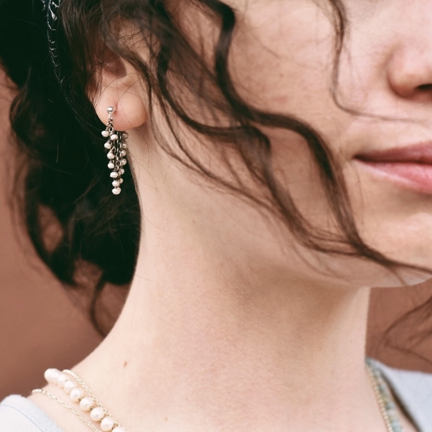 Handmade earrings with oxidized wrap around emerald