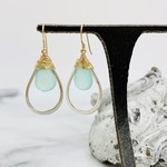 Handmade earrings with faceted aqua chalcedony wrapped in 14k gf and hanging in sterling teardrop