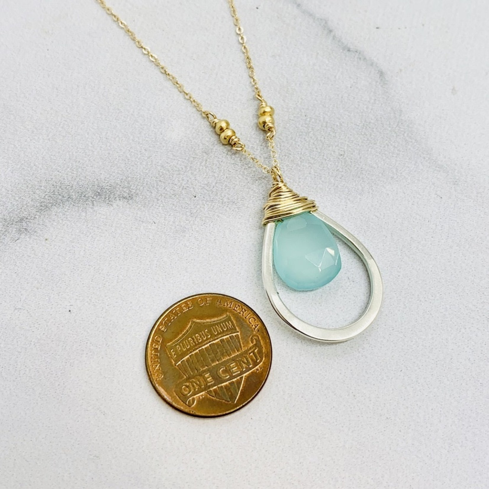 Handmade necklace with aqua chalcedony teardrop wrapped in 14k gf and nested in sterling teardrop on 16-in goldfill chain