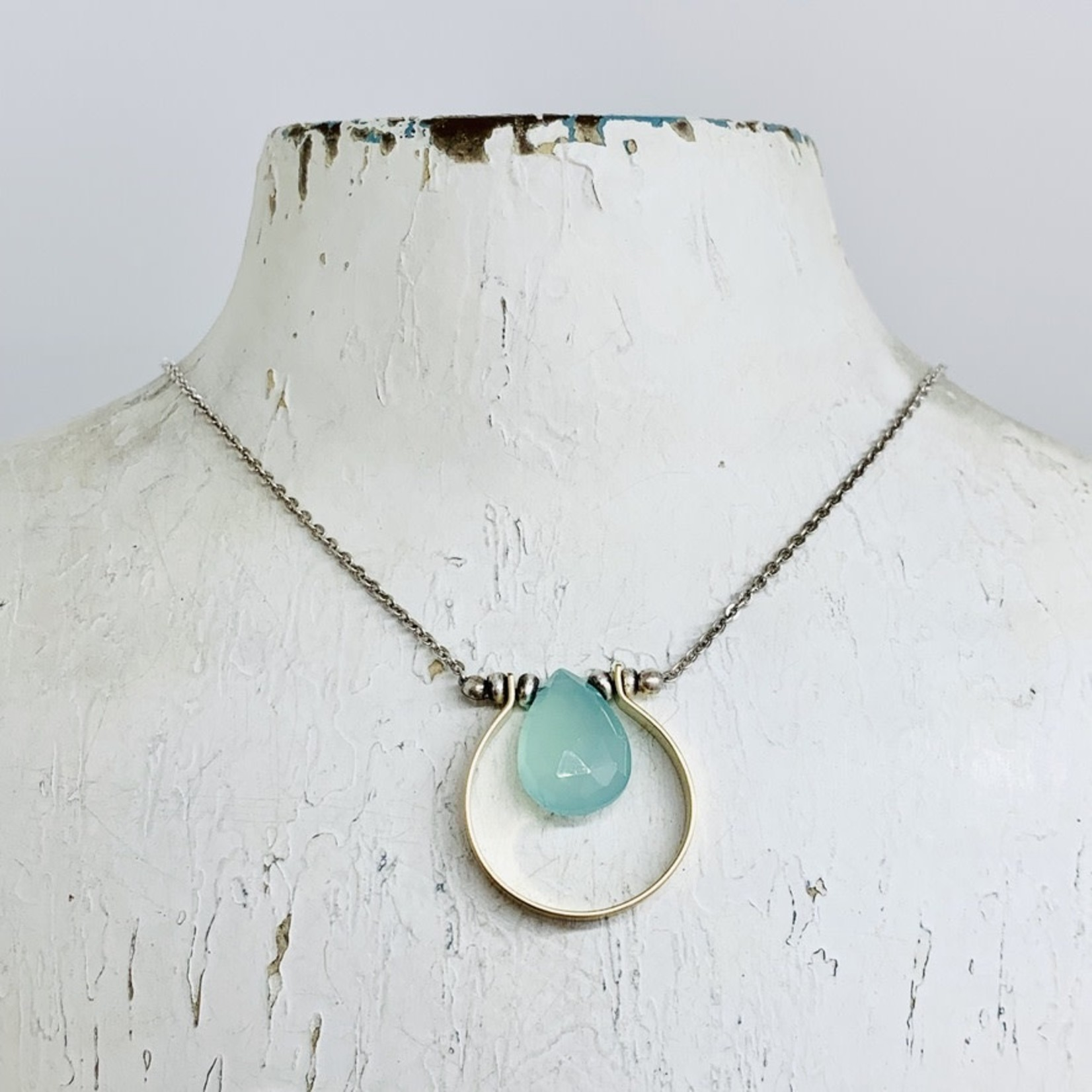 Handmade necklace with aqua chalcedony suspended in 14k gf horseshoe bead on sterling chain necklace