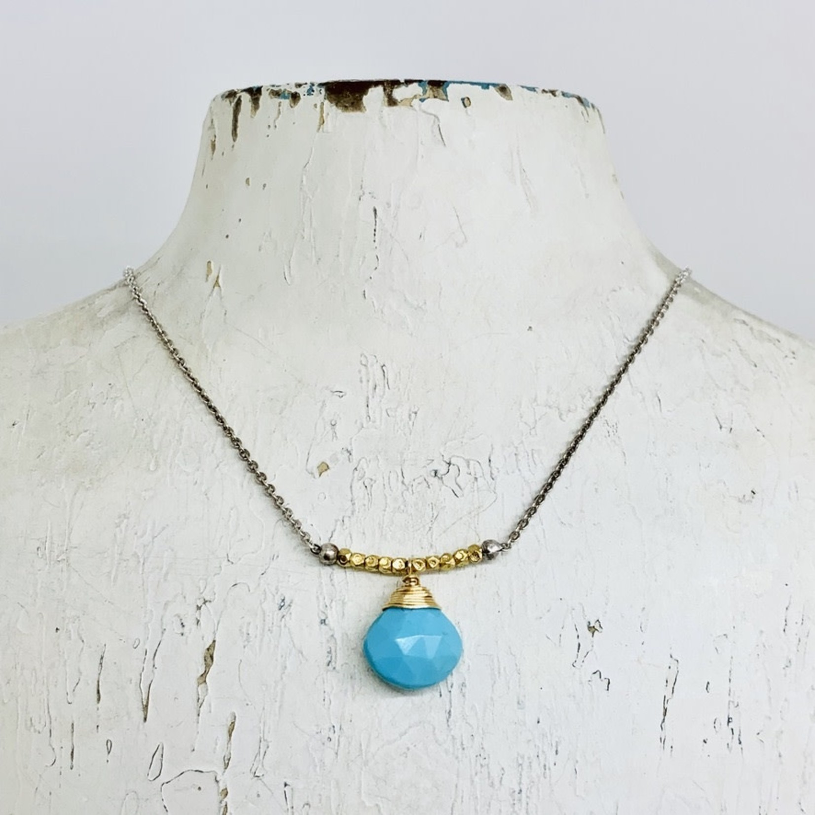 Handmade Necklace with Faceted Turquoise wrapping in 14kt gold filled wire and strung on vermeil bead and oxidized sterling chain