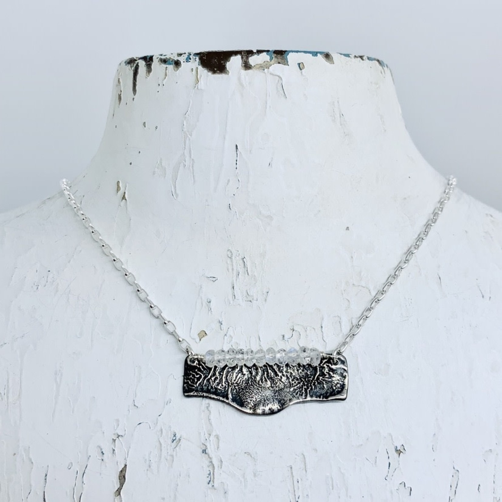EVANKNOX Handmade Necklace with oxidized reticulated silver, 9 rainbow moonstone across