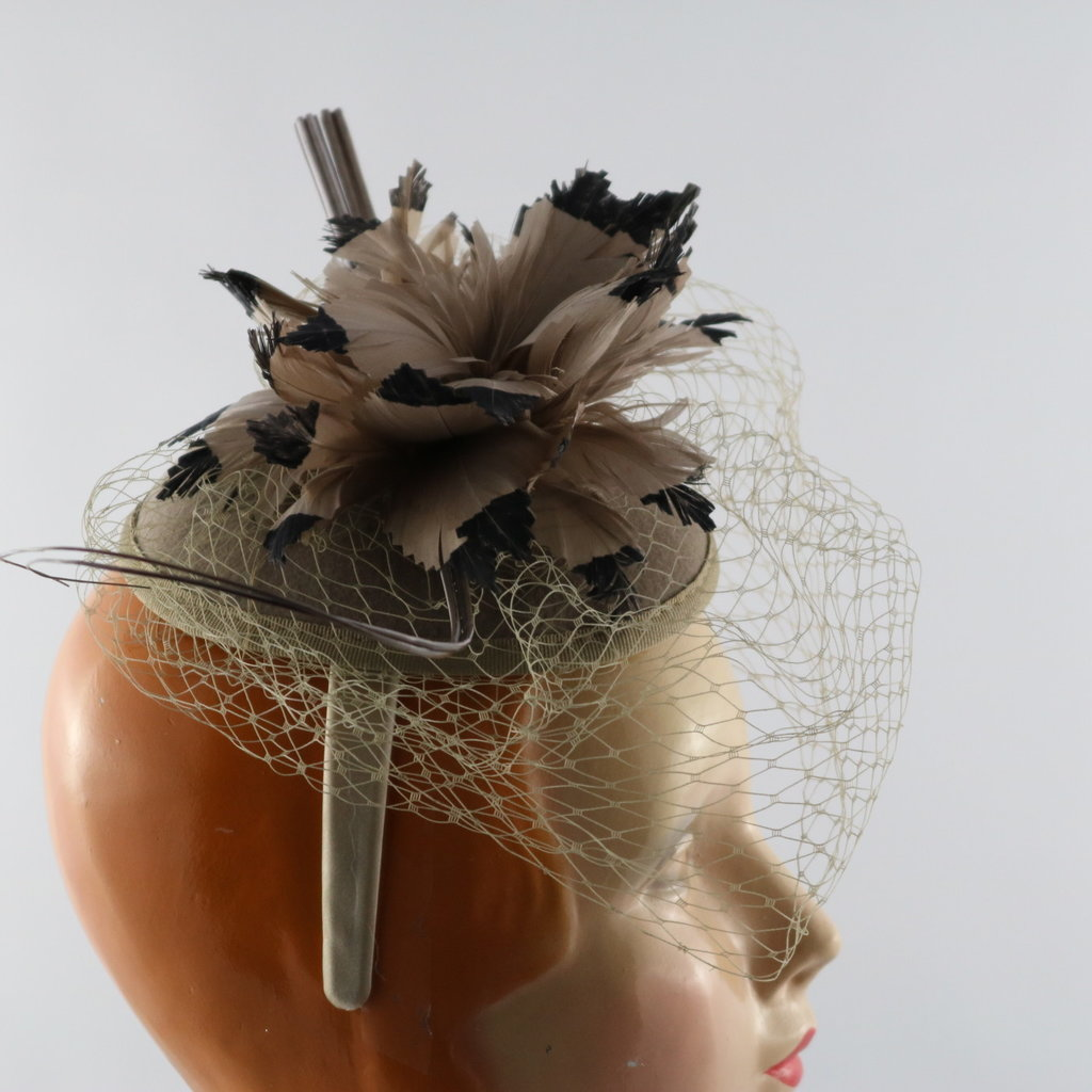 Something Special ADJUSTABLE FASCINATOR WITH NETTING AND FLOWER