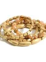 Worn Gold Bracelet Stack