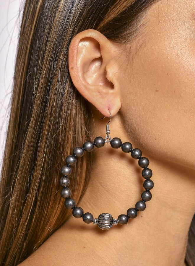 The Pooler Burnished Gunmetal Dangling Hoop Earrings with Melon Bead